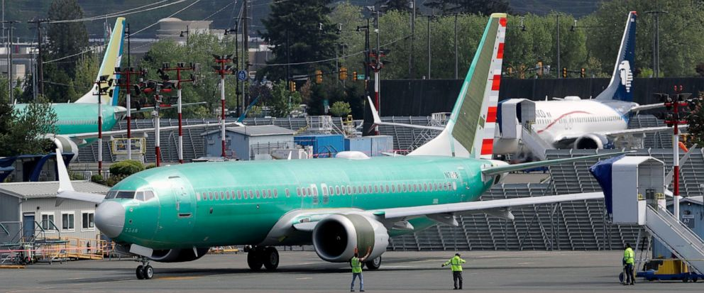 FILE - In this Wednesday, May 8, 2019 file photo, workers stand near a Boeing 737 MAX 8 jetliner being built for American Airlines prior to a test flight in Renton, Wash. The union representing Southwest Airlines pilots is suing Boeing and calling th