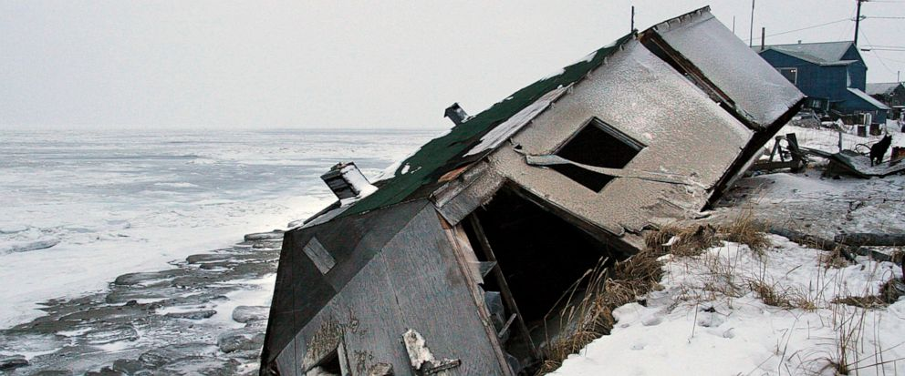 FILE - In this Dec. 8, 2006, file photo, Nathan Weyiouannas abandoned house at the west end of Shishmaref, Alaska, sits on the beach after sliding off during a fall storm in 2005. Attorneys for 12 young Alaskans who sued over state climate change po