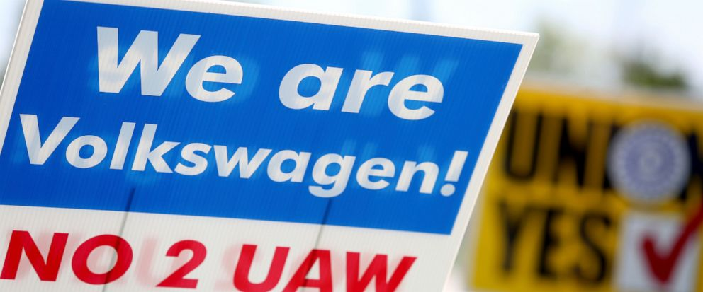 Signs for and against unionization are in a roundabout along Volkswagen Drive in front of the Volkswagen plant Friday, June 14, 2019 in Chattanooga, Tenn.. Results from the Volkswagen union election will be released later tonight. (Erin O. Smith/Chat