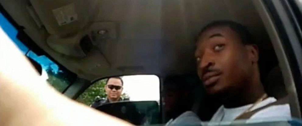 In this screenshot taken from Sept. 1, 2018, police body camera video provided by the Arlington Police Department, an officer, foreground, talks to OShae Terry after stopping him for a vehicle registration violation, in Arlington, Texas, as a second