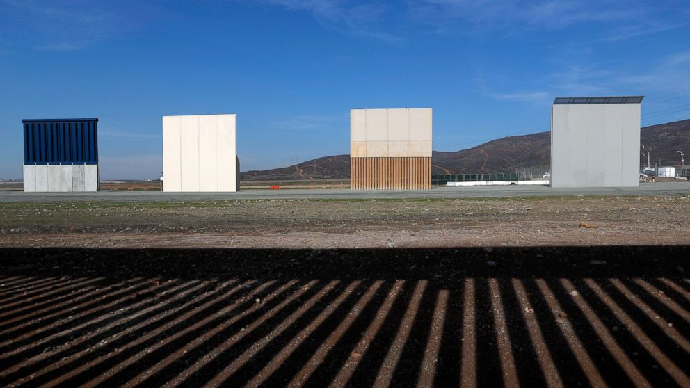 FILE - In this Wednesday, Dec. 12, 2018, file photo, border wall prototypes stand in San Diego near the Mexico-U.S. border, seen from Tijuana, Mexico, where the current wall casts a shadow in the foreground. Customs and Border Protection said Friday, Feb. 22, 2019, President Trump's eight border-wall prototypes will be torn down to make way for a secondary barrier separating California from Mexico. (AP Photo/Moises Castillo, File)