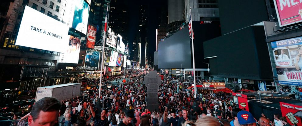 Screens in Times Square are black during a power outage, Saturday, July 13, 2019, in New York. Authorities were scrambling to restore electricity to Manhattan following a power outage that knocked out Times Squares towering electronic screens and da