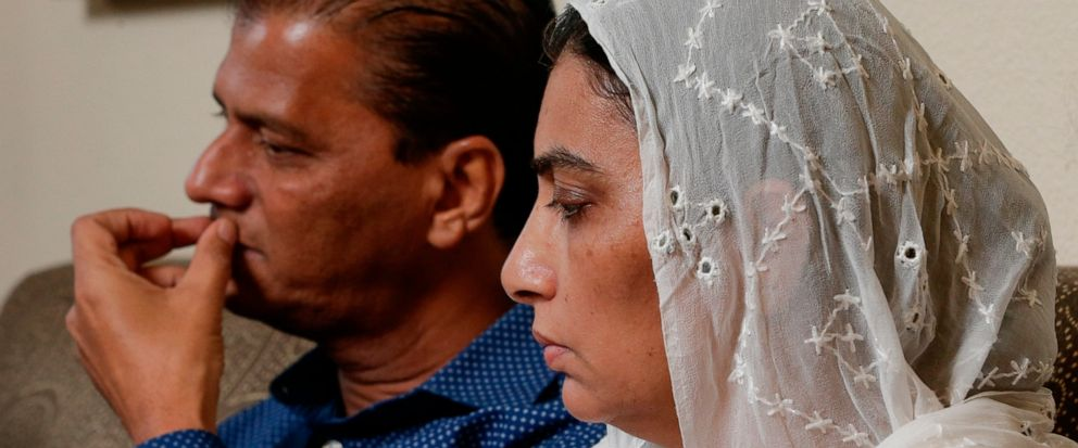 In this Wednesday July 10, 2019 photo, Abdul Aziz, left, and his wife Farah Naz, the parents of Santa Fe High School shooting victim Sabika Aziz Sheikh, 17, talk about the impact of Sabikas death during an interview at their home in Houston. (AP Pho