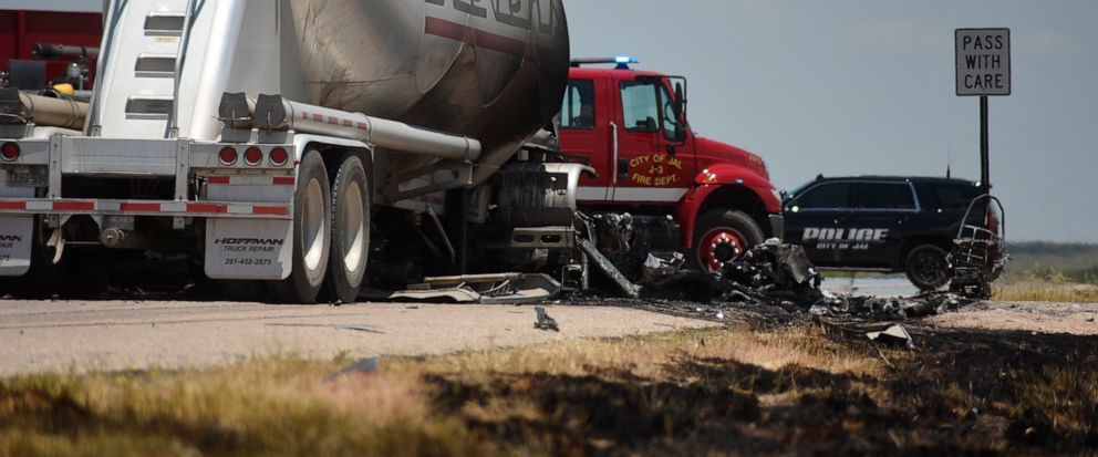 Grass along New Mexico State Route 128 near Jal shows burn marks following a fatal head-on crash Thursday, July 11, 2019. Authorities say four oilfield workers traveling in a pickup truck and the driver of a big rig were pronounced dead at the scene.