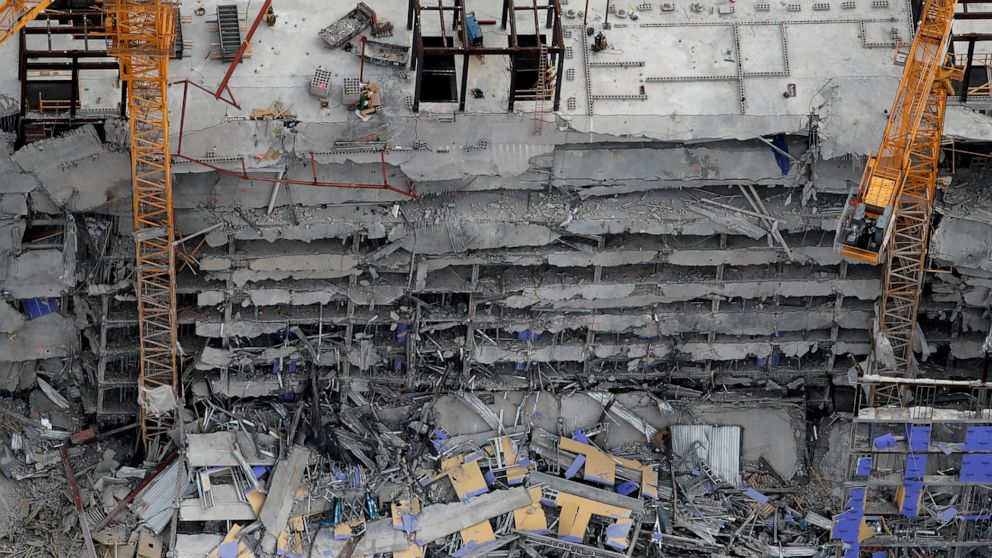 The Latest: 1 dead, 2 still missing after building collapse thumbnail