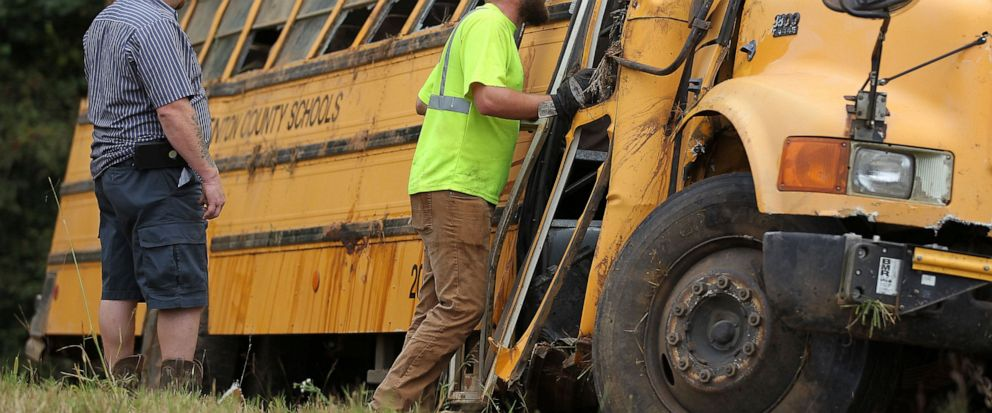 Wrecker crews inspect the damage to a Benton County School bus that was involved in wreck along U.S. Highway 72 near Walnut, Miss., Tuesday, Sept. 10, 2019, that resulted in the death of the driver and sent several students to the hospital. (Thomas W
