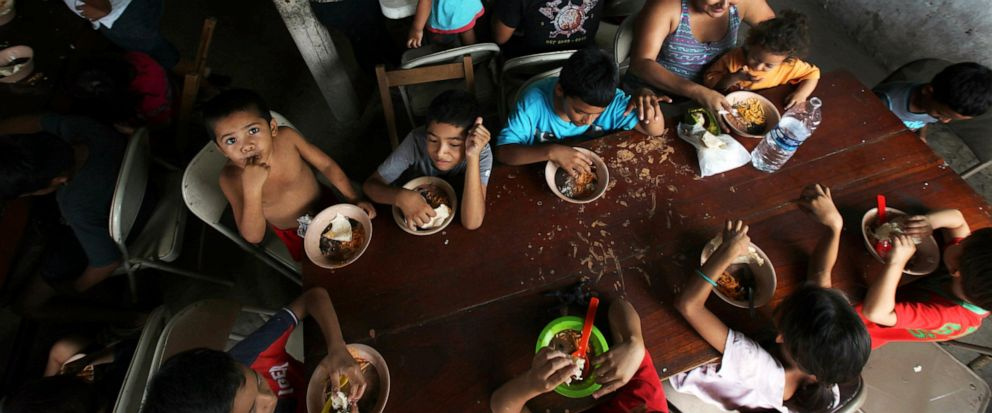 FILE - In this May 30, 2019 file photo, Honduran migrant children eat a meal at the Jesus el Buen Pastor del Pobre y el Migrante shelter in Tapachula, Chiapas state, Mexico. The federal government will be opening a facility at an Army base in Oklahom