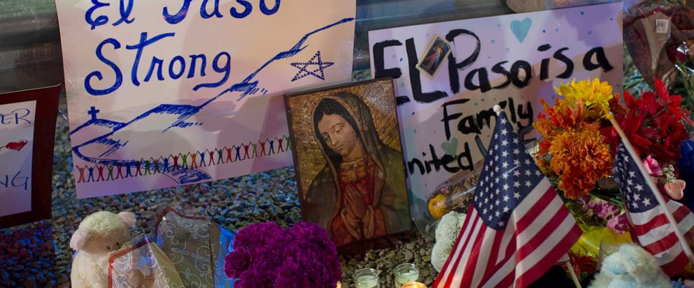 FILE - In this Aug. 4, 2019 file photo, a Virgin Mary painting, flags and flowers adorn a makeshift memorial for the victims of the mass shooting at a Walmart in El Paso, Texas. A man whose 63-year-old wife was among the Texas mass shooting victims s