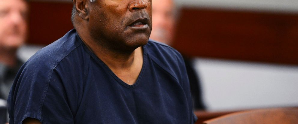 FILE - In this May 14, 2013, file photo, O.J. Simpson appears at an evidentiary hearing in Clark County District Court in Las Vegas. In a letter that surfaced after her 1994 death, Nicole Brown Simpson detailed the fear and violence that framed her m