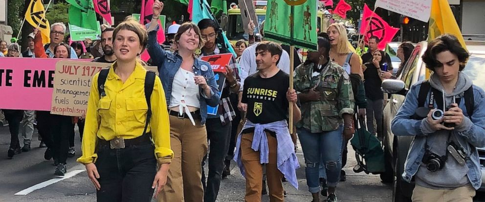 In this photo taken June 21, 2019, people demonstrating to raise awareness of climate change blocked streets in downtown Portland, Ore. The divide in Oregon between the state's liberal, urban population centers and its conservative and economically d