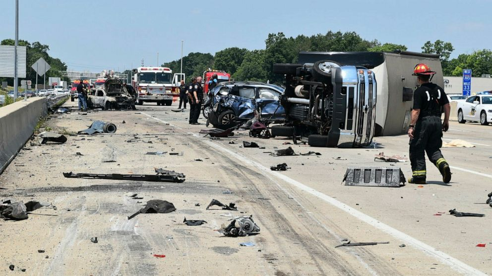 Trucker charged in highway crash killing mom, 2 kids