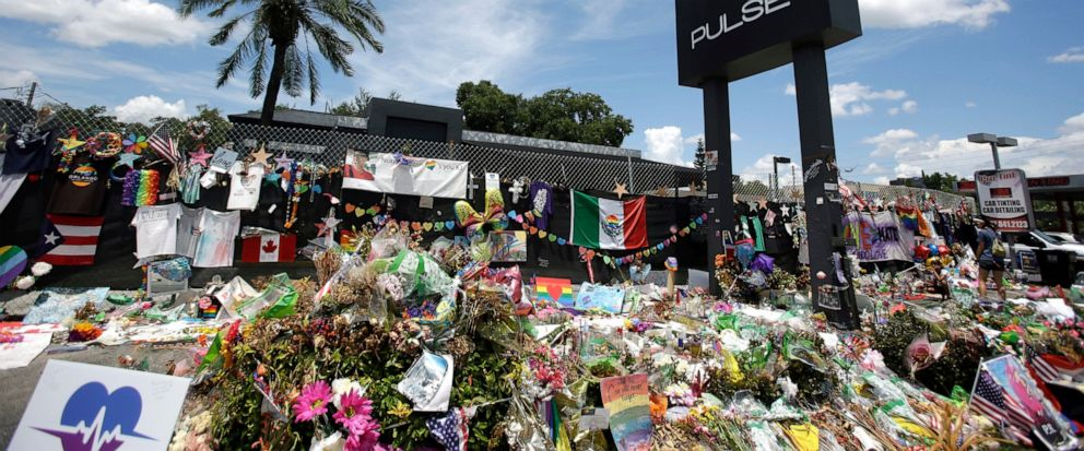 FILE - In this July 11, 2016, file photo, a makeshift memorial continues to grow outside the Pulse nightclub in Orlando, the day before the one month anniversary of a mass shooting, in Orlando, Fla. A group of survivors and family members of those ki