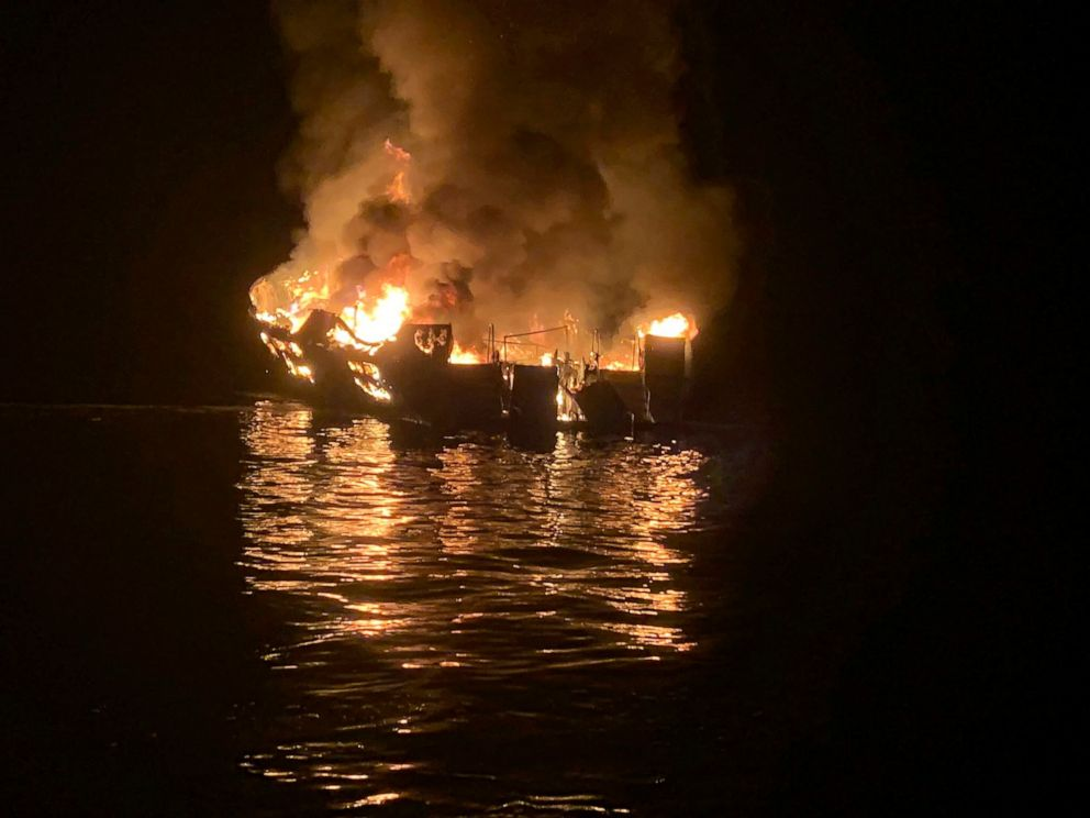 FILE - In this Sept. 2, 2019, file photo, provided by the Santa Barbara County Fire Department, a dive boat is engulfed in flames after a deadly fire broke out aboard the commercial scuba diving vessel off the Southern California Coast. The owners of