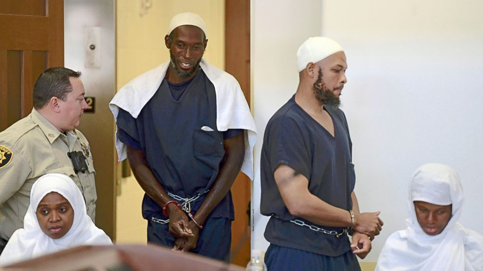 FILE - This Aug. 13, 2018 pool file photo shows defendants, from left, Jany Leveille, Lucas Morton, Siraj Ibn Wahhaj and Subbannah Wahhaj entering district court in Taos, N.M., for a detention hearing. Five former residents of a New Mexico compound where authorities found 11 hungry children and a dead 3-year-old boy are due in federal court on terrorism-related charges. The two men and three women living at the compound raided in August are being arraigned Thursday, March 21, 2019, on new charges of supporting plans for violent attacks. (Roberto E. Rosales/The Albuquerque Journal via AP, Pool, File)