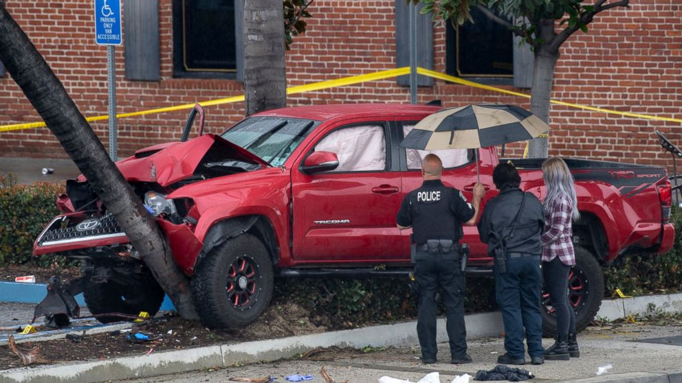 Fullerton Police investigate an early-morning accident that injured several pedestrians, Sunday, Feb. 10, 2019, in Fullerton, Calif. Authorities say a suspected drunken driver was arrested after his pickup truck plowed into a crowd on a sidewalk, injuring multiple people, including some victims who were trapped under the vehicle. (Mindy Schauer/The Orange County Register via AP)
