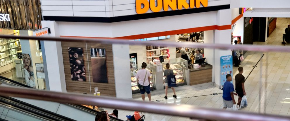 In this Aug. 7, 2019, photo shoppers ride an escalator inside the Glendale Galleria in Glendale, Calif. If a threat of a recession gives you pause when it comes to your personal finances, remember now is a time to prepare, not panic. Financial expert