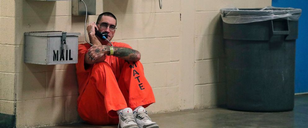 FILE - In this Nov. 27, 2017 file photo, inmate Lance Shaver talks on the phone at the Albany County Correctional Facility in Albany, N.Y. Connecticut is considering legislation which would make phone calls from prison free to inmates. (AP Photo/Juli