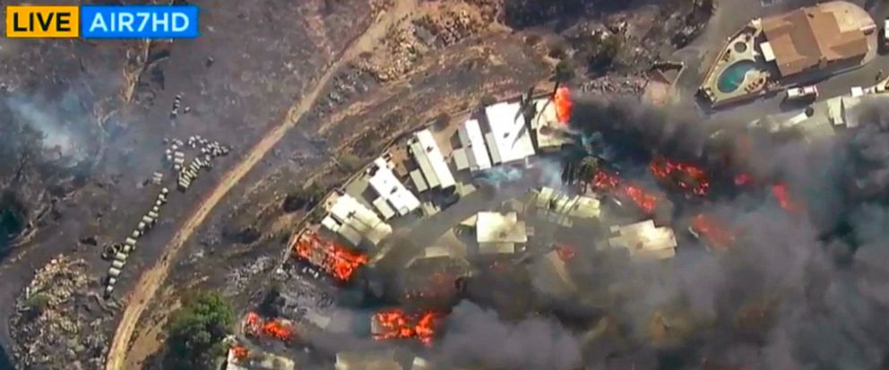 This photo from video provided by KABC-TV shows Strong, gusting winds push flames through the Villa Calimesa mobile home park in Calimesa, Calif., southeast of San Bernardino, Thursday, Oct. 10, 2019. Multiple residences have burned in the fire, that