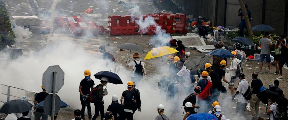 Riot police fire tear gas to protesters outside the Legislative Council in Hong Kong, Wednesday, June 12, 2019. Hong Kong police have used tear gas and high-pressure hoses against thousands of protesters opposing a highly controversial extradition bi