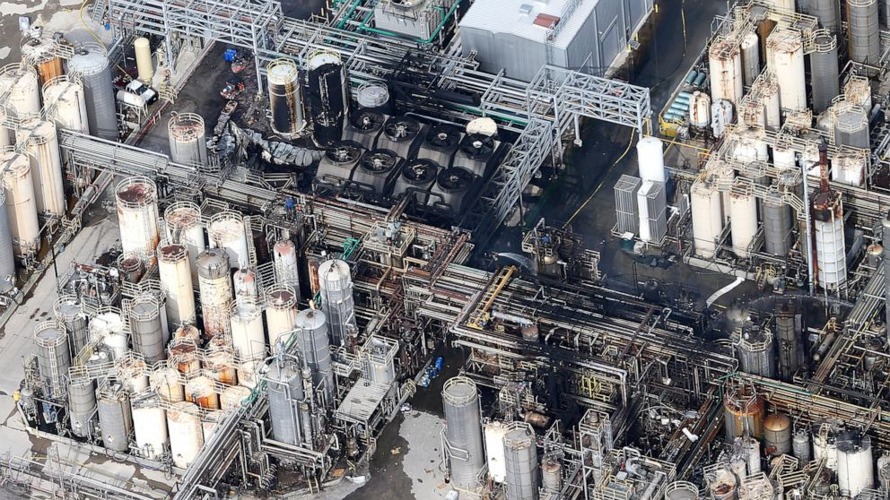 This aerial photo shows the KMCO chemical plant as firefighters spray water on a fire on Tuesday, April 2, 2019, in Crosby, Texas. Pilar Davis, a product manager with KMCO, says the fire initially ignited with isobutylene and was fueled by ethanol and ethyl acrylate. All three are chemicals and solvents used to make fuel additives at the plant. (Elizabeth Conley/Houston Chronicle via AP)