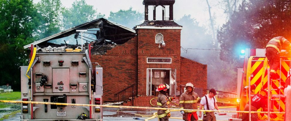 FILE - In this April 4, 2019 file photo, firefighters and fire investigators respond to a fire at Mt. Pleasant Baptist Church, in Opelousas, La. Authorities have arrested a person in connection with suspicious fires at three historic black churches i