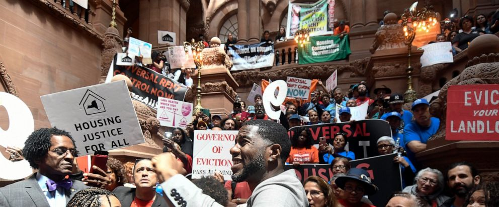 FILE - In this June 4, 2019 file photo, Jumaane Williams, Public Advocate for the City of New York, center, speaks with tenants and members of the Upstate Downstate Housing Alliance from across the state, demanding New York Gov. Andrew Cuomo and stat
