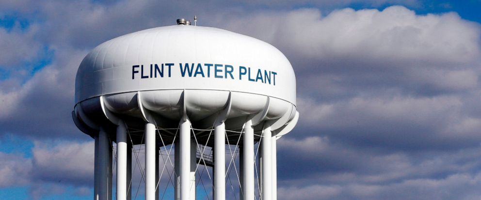 FILE - In this March 21, 2016 file photo, the Flint Water Plant water tower is seen in Flint, Mich. Prosecutors dropped all criminal charges Thursday, June 13, 2019, against eight people in the Flint water scandal and pledged to start the investigati