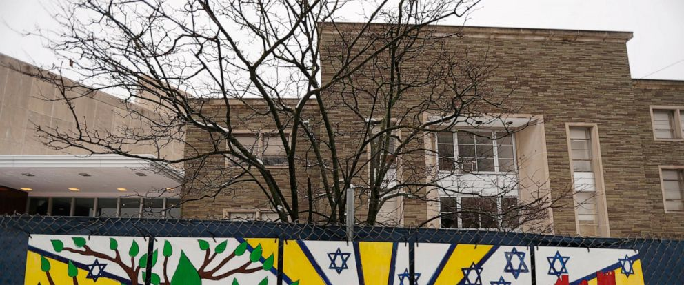 FILE--This file photo from Feb. 11, 2019 shows artwork on a fence around the Tree of Life Synagogue in Pittsburgh where 11 people were killed and seven others injured during an attack on in October of 2018. The synagogue is inviting young people worl