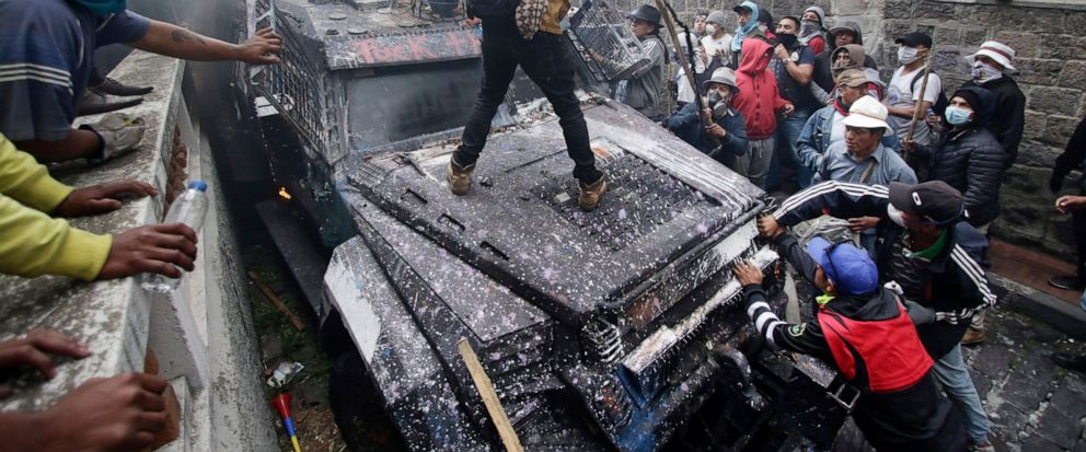 Anti-government demonstrators commandeer an armored vehicle during a nationwide strike against President Lenin Moreno and his economic policies, in Quito, Ecuador, Wednesday, Oct. 9, 2019. Big jumps in the costs of gasoline and diesel after Moreno en