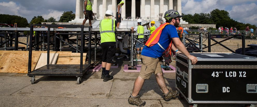 The stage is dismantled as clean up is underway after the Fourth of July celebrations in front of the Lincoln Memorial, Friday, July 5, 2019, in Washington. (AP Photo/Alex Brandon)