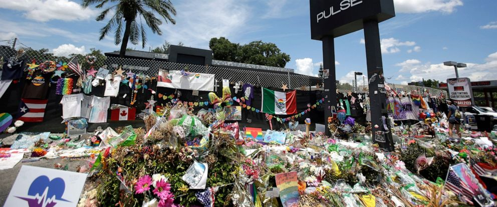 FILE - In this July 11, 2016, file photo, a makeshift memorial continues to grow outside the Pulse nightclub in Orlando, the day before the one month anniversary of a mass shooting, in Orlando, Fla. Floridians and others around the world are remember