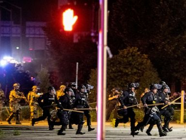 Louisville police and soldiers return fire, killing man