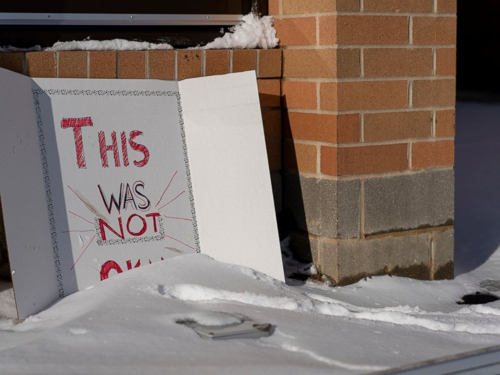 A sign reading This was not okay, is seen in front of Covington Catholic High School in Park Kills, Ky., Sunday, Jan 20, 2019. A diocese in Kentucky has apologized after videos emerged showing students from the Catholic boys high school mocking Na