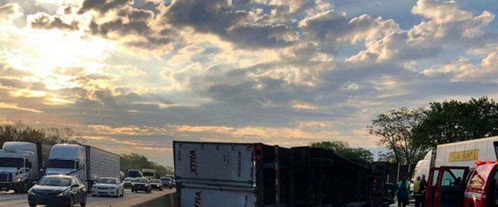 This photo released by the Indiana State Police shows a semi-trailer hauling honey overturned on a northwestern Indiana highway, spilling some of the sticky substance and restricting travel for hours in Hammond, Ind., Wednesday, May 15, 2019. State p