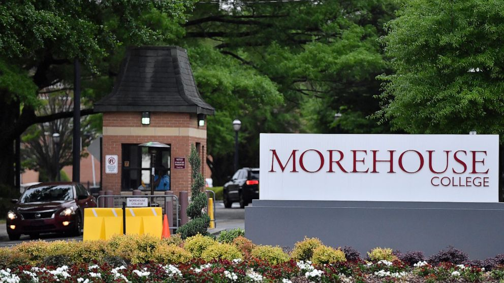 In this Friday, April 12, 2019 photo, people enter the campus of Morehouse College in Atlanta. The country's only all-male historically black college will begin admitting transgender men next year. The move marks a major shift for Morehouse College at a time when higher education institutions around the nation are adopting more welcoming policies toward LGBT students. Morehouse College leaders told The Associated Press that its board of trustees approved the policy Saturday. (AP Photo/Mike Stewart)