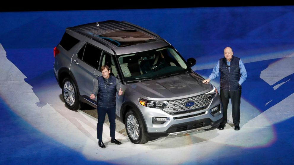 FILE - In this Wednesday, Jan. 9, 2019 file photo, Ford Motor Co., President, Global Markets Jim Farley, left, and President and CEO Jim Hackett stand next to the redesigned 2020 Ford Explorer during its unveiling, in Detroit. SUVs and a big pickup truck will get top billing at Detroit's auto show this year, but there are some surprise sports cars and electric vehicles on the agenda. The most popular vehicle of the bunch is the Ford Explorer, revealed ahead of the show Wednesday night at Ford Field, the home of the National Football League's Detroit Lions. (AP Photo/Carlos Osorio, File)