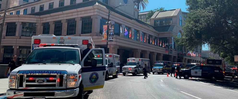 Fire crews gather on Market Street outside the Hotel Fairmont in downtown San Jose, Calif., after a report of a chemical odor Saturday, Aug. 31, 2019. Authorities say at least one woman has died and several people have been sickened in a hazmat incid
