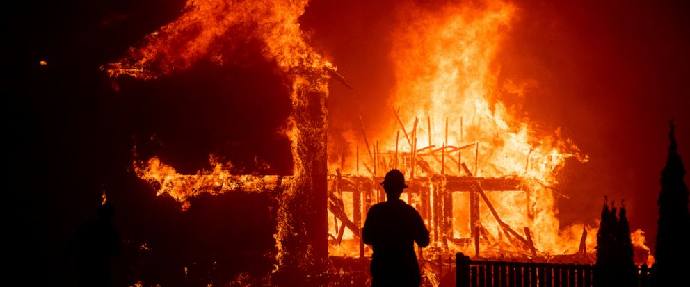 FILE - In this Nov. 8, 2018 file photo a home burns as the Camp Fire rages through Paradise, Calif. California fire authorities say that Pacific Gas and Electric equipment was responsible for the deadliest and most destructive wildfire in state histo