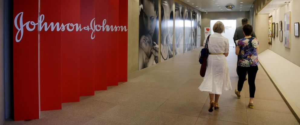 FILE - In this July 30, 2013, file photo, people walk along a corridor at the headquarters of Johnson & Johnson in New Brunswick, N.J. A Philadelphia jury has ruled that Johnson & Johnson and Janssen Pharmaceuticals must pay $8 billion in punitive da