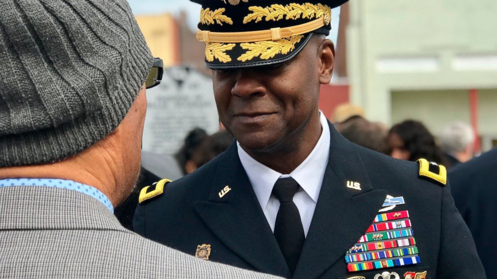 Brig. Gen. Milford H. Beagle, Jr., commanding general of Fort Jackson, speaks to the president of the Sgt. Isaac Woodard Historical Marker Association following the dedication ceremony in Batesburg-Leesville, S.C., on Saturday, Feb. 9, 2019. (AP Photo/Christina Myers)