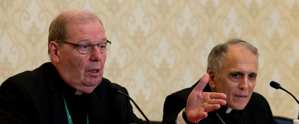 Robert Deeley, left, Bishop of the Diocese of Portland, accompanied by Cardinal Daniel DiNardo, of the Archdiocese of Galveston-Houston and President of the United States Conference of Catholic Bishops (USCCB), speaks during a news conference at the