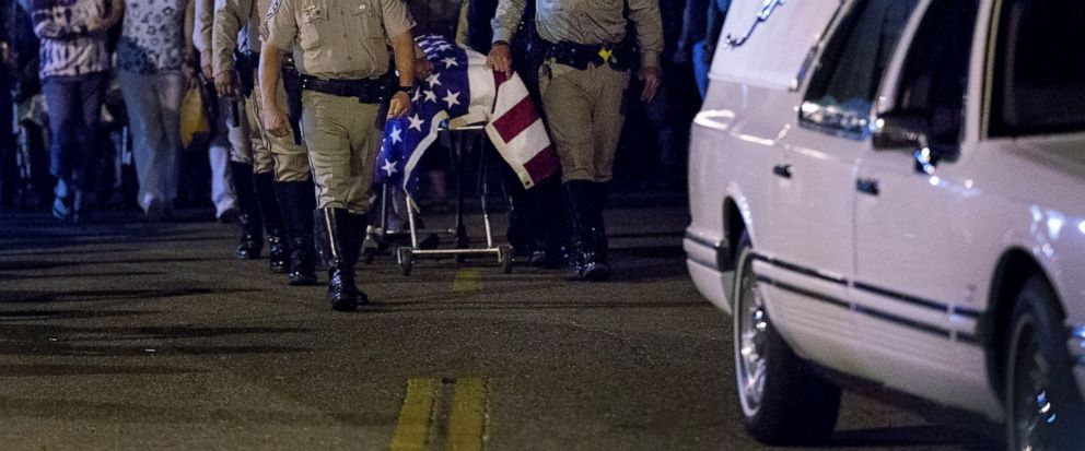 The casket of slain CHP officer Andre Moye is transported to a hearse from the Riverside University Health Systems Medical Center after he was shot and killed while two fellow officers were wounded during a traffic stop on Eastridge Avenue overpass o