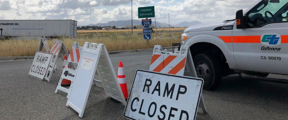 An on ramp to Interstate 215 is closed off on Friday, May 17, 2019, in California. A wide area including the 215 freeway remained off-limits around an F-16 fighter jet crash site in Southern California on Friday as military and civilian authorities i