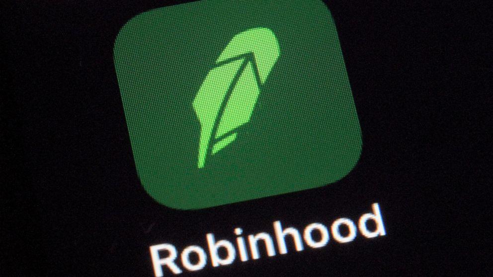 In Robinhood's Wall Street debut, stock swings sharply