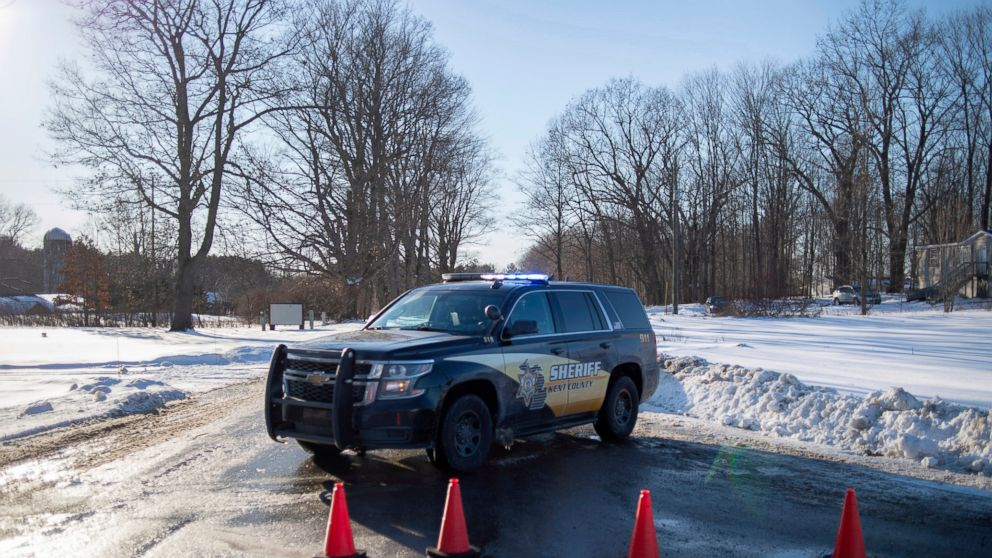 Kent County Sheriff personnel investigate the scene of a fatal shooting near the corner of 19 Mile NE and Division Avenue NE at a property on Monday, Feb. 18, 2019, near Cedar Springs, Mich. WOOD-TV reports Kent County Sheriff Michelle LaJoye-Young says authorities discovered the victims at a property near Cedar Springs, a community about 30 miles north of Grand Rapids. (Neil Blake/MLive.com/The Grand Rapids Press via AP)