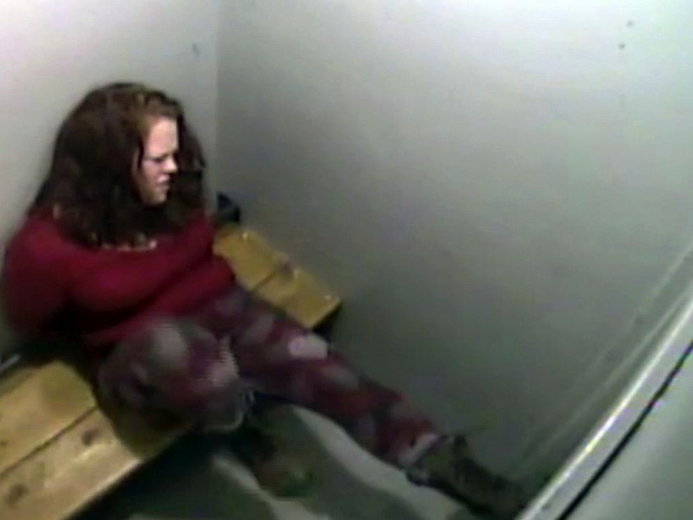 In this March 14, 2019, image from surveillance video released by the St. Albans Police Department, Amy Connelly kicks the door of a holding cell at the police station in St. Albans, Vt. The police chief said he has changed the use-of-force reporting