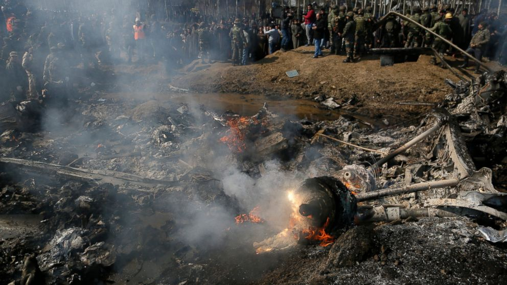 Kashmiri Villagers And Indian Army Solrs Gather Near The Wreckage Of An Aircraft After It