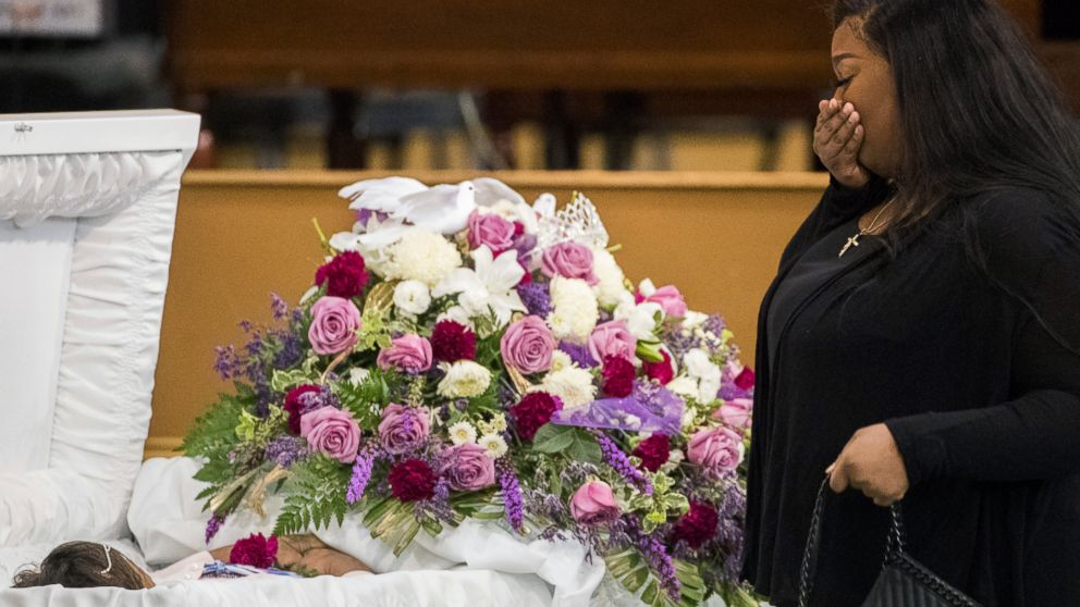 A mourner approaches the casket of Jazmine Barnes during a viewing ceremony before the memorial services on Tuesday, Jan. 8, 2019 at the Community of Faith Church in Houston. Barnes was fatally shot, Dec. 30, 2019, while in a car with her family during an attack that investigators say appears to be a case of mistaken identity. (Marie De Jesus/Houston Chronicle via AP)