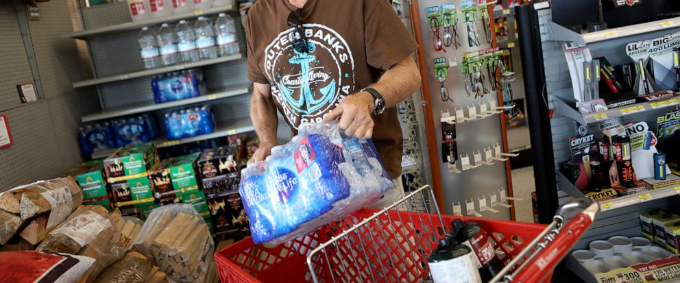 James Cooke is shown buying water bottles along with propane tanks and batteries at a ACE Hardware store as he prepares for a possible power shutdown in Los Gatos, Calif., on Tuesday, Oct. 8, 2019. Millions of people were poised to lose electricity t