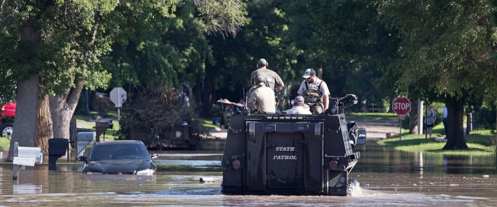 The Nebraska State Patrol patrols a flooded street Wednesday, July 10, 2019, in Gibbon, Neb. Runoff from heavy rains in south-central Nebraska is moving down several rivers, posing new flood threats. (Jeff Bundy/The World-Herald via AP)